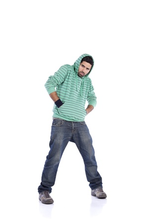 Young rapper posing isolated on white (selective focus) photo