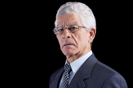 Powerful businessman portrait (isolated on black) Stock Photo