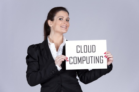 Businesswoman holding a paper with the Cloud Computing words (selective focus) photo