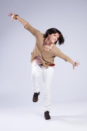 Beautiful mature woman dancing, jumping and having fun photo