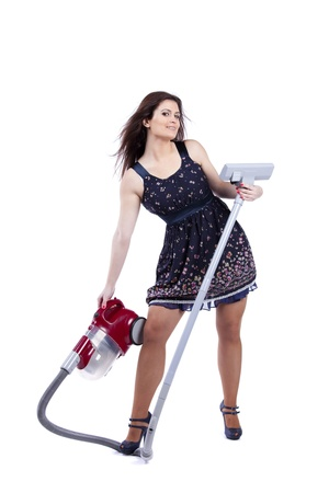 sexy housewife: Modern and sexy young housewife posing with the vacuum cleaner (isolated on white) Stock Photo