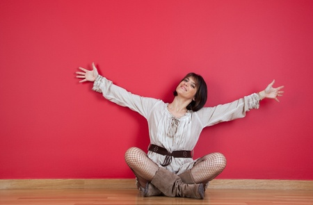 happy mature women sited in the floor of his new house Stock Photo - 10035757