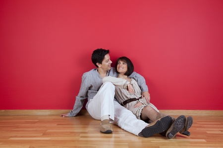 mature couple sited in the floor of his new house photo
