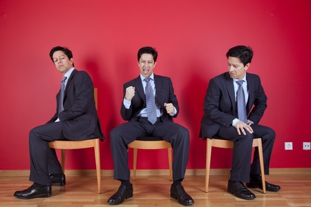 One successful businessman between two jealous businessman Stock Photo - 10035763