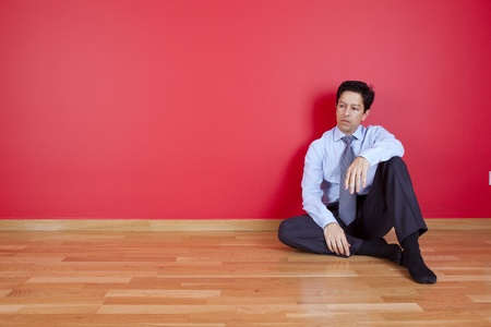 sited: businessman sited in the floor of his new house