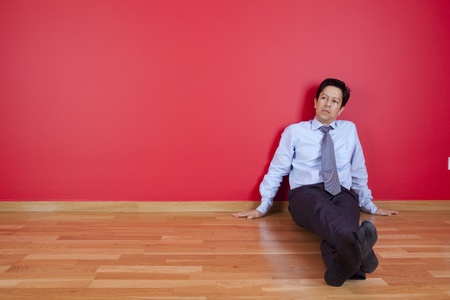 businessman sitting in the floor of his new house Stock Photo - 10035762