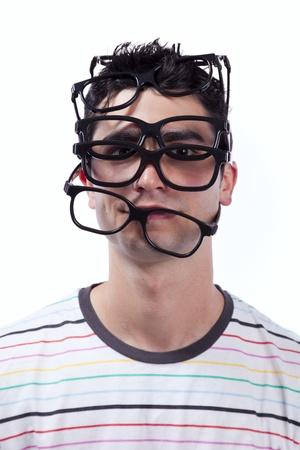 glass eye: Joven lleno de gafas en la cabeza (aislado en blanco) Foto de archivo