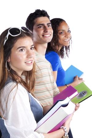 Three happy students holding books (isolated on white) Stock Photo - 10048395