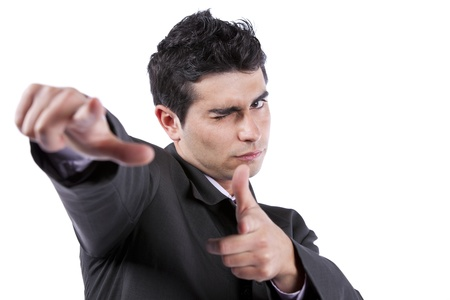 Young businessman blinking his eye and pointing to you (isolated on white) Stock Photo - 10035660