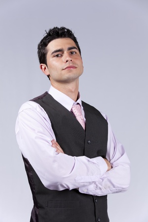 Powerful young businessman with his arms crossed (isolated on gray) Stock Photo - 10035706