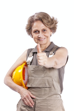 woman hard working: Happy senior woman holding a safety hat (isolated on white)