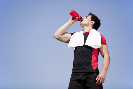 sweaty: Tired athlete refreshing him self with fresh water Stock Photo
