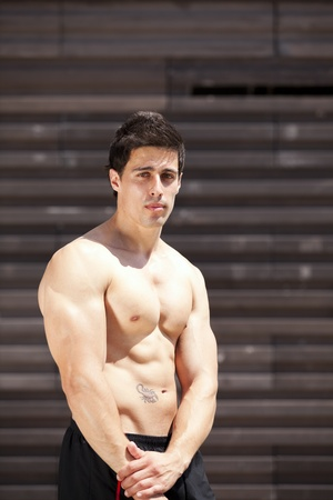 Powerful athlete showing his muscles photo