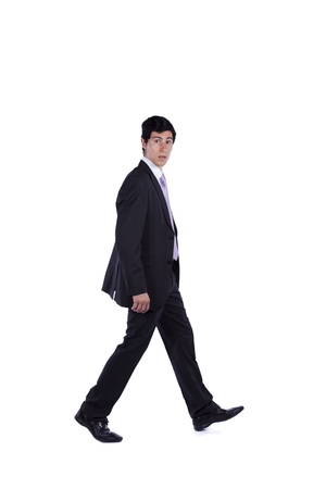 Businessman walking and looking to you isolated on white (some motion blur) Stock Photo - 10035607