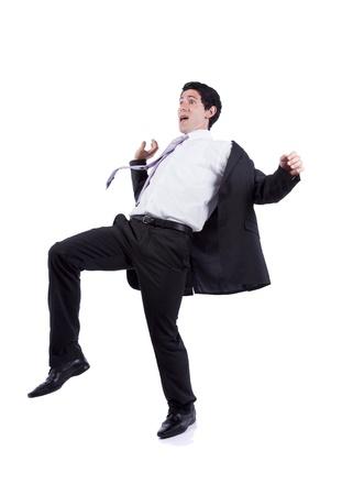 hombre cayendose: Empresario asustado en una posición de caída (aislado en blanco) Foto de archivo