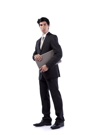 Businessman standing with a laptop (isolated on white) photo