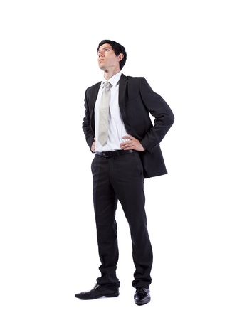 Successful businessman looking up to the copy space (isolated on white)