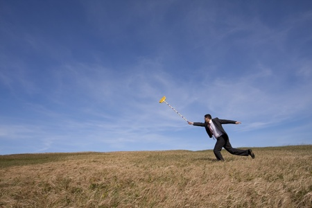 businessman cleaning the field with a broom photo