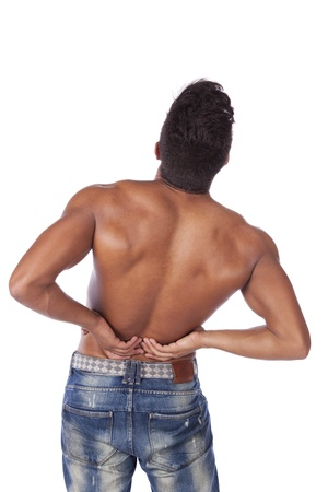 Young man with back pain massaging his muscles (isolated on white) photo