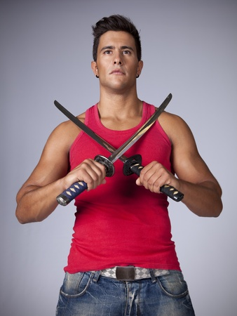 Young warr with two swords Stock Photo - 11017703