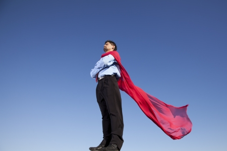 Businessman with a red flying cape like superman