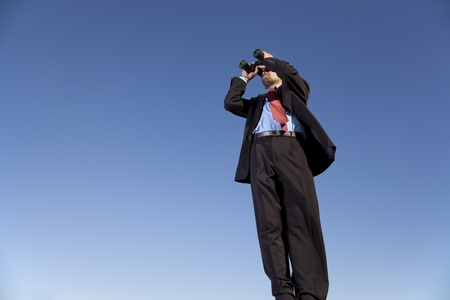Businessman looking through his binoculars in outdoor Stock Photo - 11017579