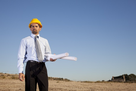 Businessman with blue prints at the field Stock Photo - 11017622