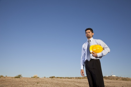Engineer Businessman at the field holding a hardhat Stock Photo - 11017614