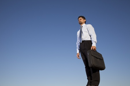 Successful businessman holding a briefcase in outdoor Stock Photo - 11017581