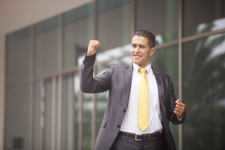 Happy businessman celebrating his success photo