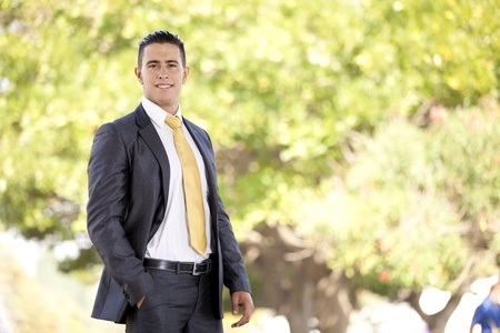 Happy young businessman at the city park Stock Photo - 11017597