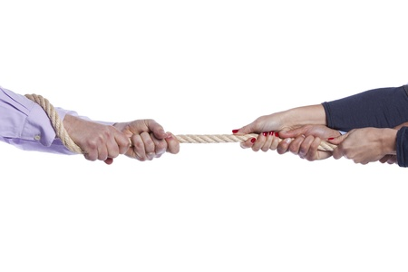 Group of woman hands pulling a rope competing with a man (selective focus) Stock Photo - 11017321