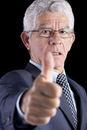 Businessman gesturing OK with his thumb (isolated on black) Stock Photo - 11017738