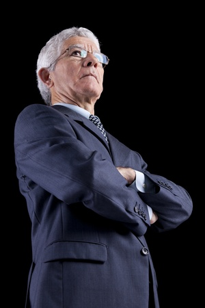 powerful man: Powerful businessman portrait (isolated on black) Stock Photo