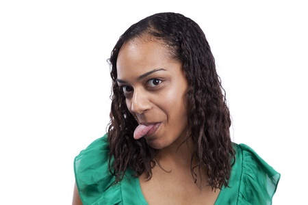 African woman with her tongue out (isolated on white) photo