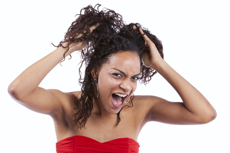 hair problem: african woman pulling her hair off in stress (isolated in white)  Stock Photo