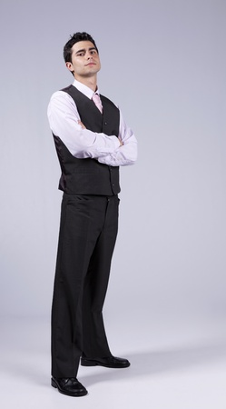 Powerful young businessman with his arms crossed (isolated on gray) Stock Photo - 11017562