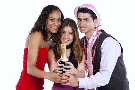 Three happy young friends celebrating the New Year party (isolated on white) photo