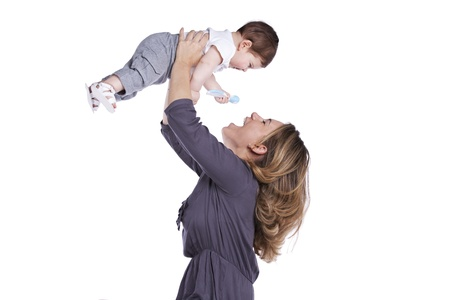 Happy mother playing with her baby son (isolated on white) photo