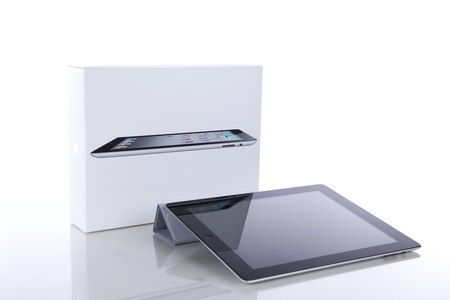 Lisbon, Portugal - June 26, 2011: iPad2 Wi-Fi 64Gb + 3G with Smart cover and original box. The second generation iPad, is used viewing web, e-mails, electronic books, photos, videos, playing games and more, was released for sale by Apple Inc. on March 11,