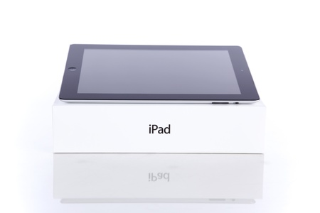 Lisbon, Portugal - June 26, 2011: iPad2 Wi-Fi 64Gb + 3G with original box. The second generation iPad, is used viewing web, e-mails, electronic books, photos, videos, playing games and more, was released for sale by Apple Inc. on March 11, 2011.