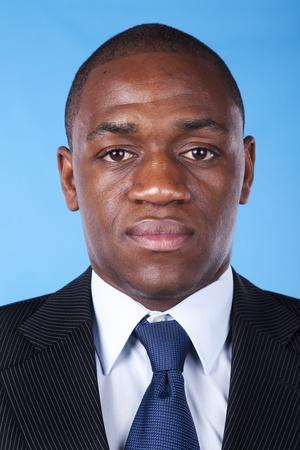 handsome men: African businessman portrait (blue background)