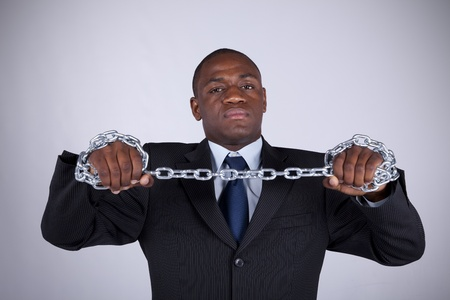 dominate: Powerful african businessman with a steel chain in his hands