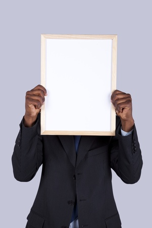hide: african businessman holding a blank whiteboard
