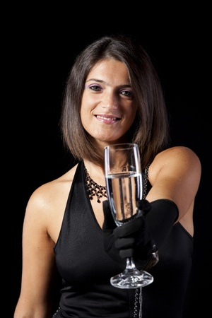beautiful woman celebrating the new year eve with champagne (isolated on black) photo