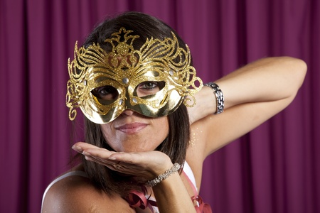 beautiful and sexy woman with a seductive mask photo