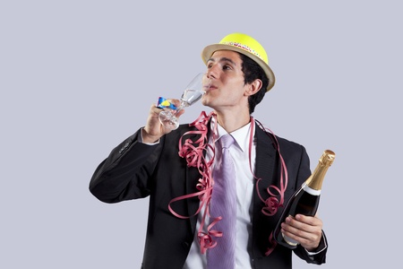 businessman celebrating the new year eve with champagne (isolated on black) photo