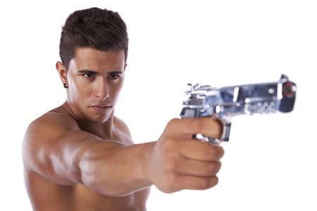 Powerful young man with a gun (selective focus) Stock Photo - 16466167