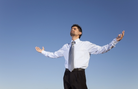 Businessman man looking to the sky with his arms outstretched Stock Photo - 16466182