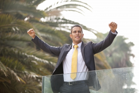 Happy businessman celebrating his success photo